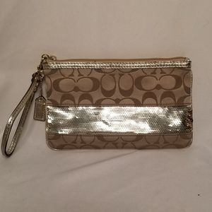 Coach large wristlet with gold sequin detail